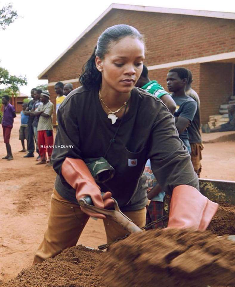 Her Excellency, Rihanna spotted carrying sand and water (pictures)