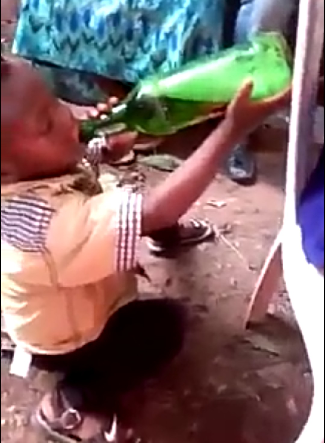 Shocking as Two year old kid drinks two bottles of beer (video)