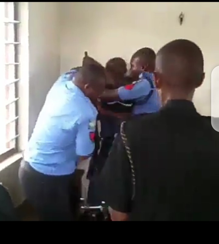 Nigeria Police Men Fight with a Civil defense Corps officer with guns (video)