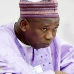 Governor Ganduje's Scandalous Dollar Video Seen On The Biggest Roundabout Billboard In Edo